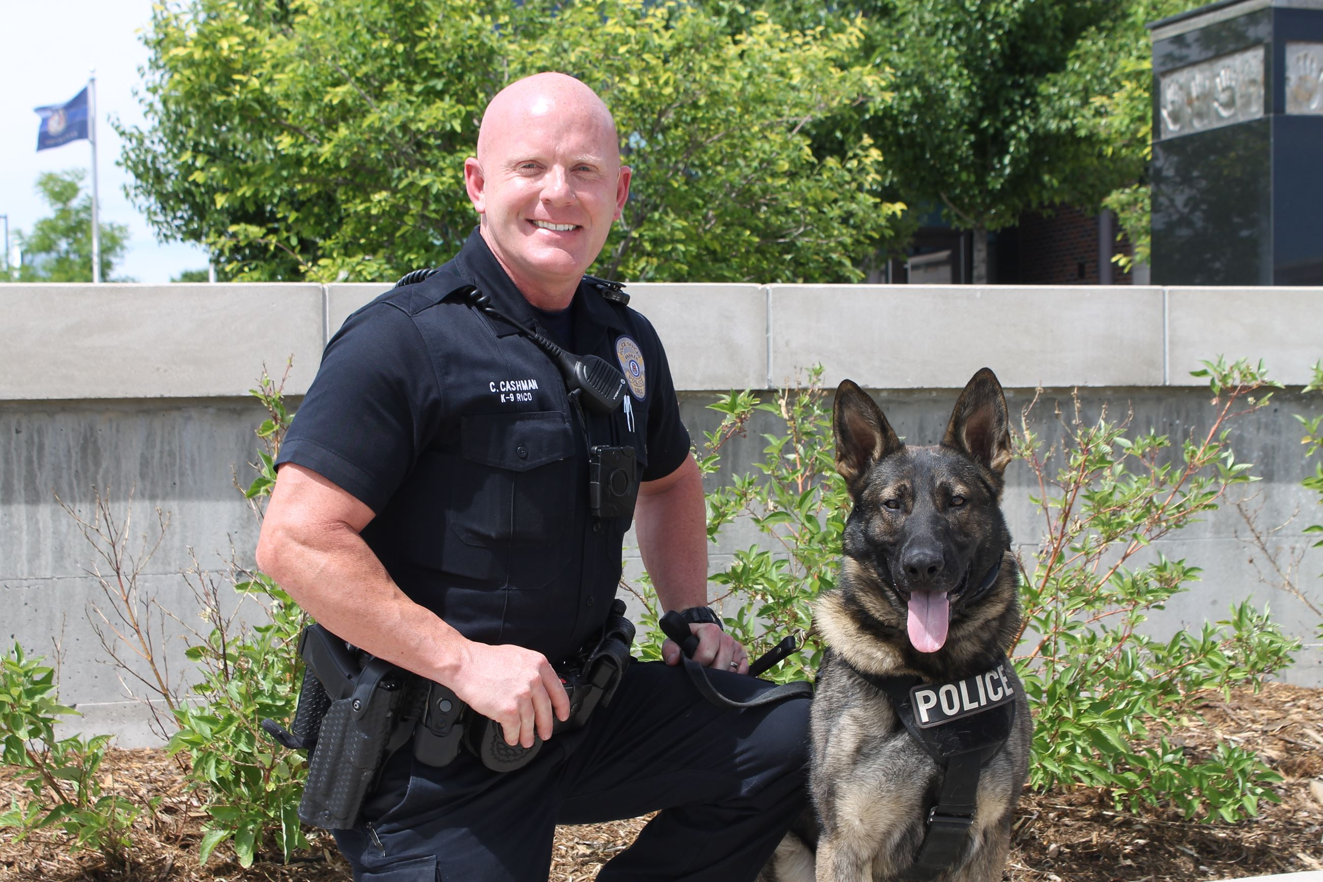 Officer Cashman kneeling next to Rico
