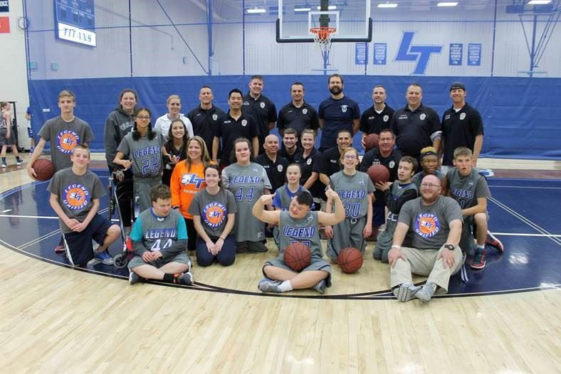 Parker PD and Legend Unified athletes pose for a photo before the Basketball Game in 2017.