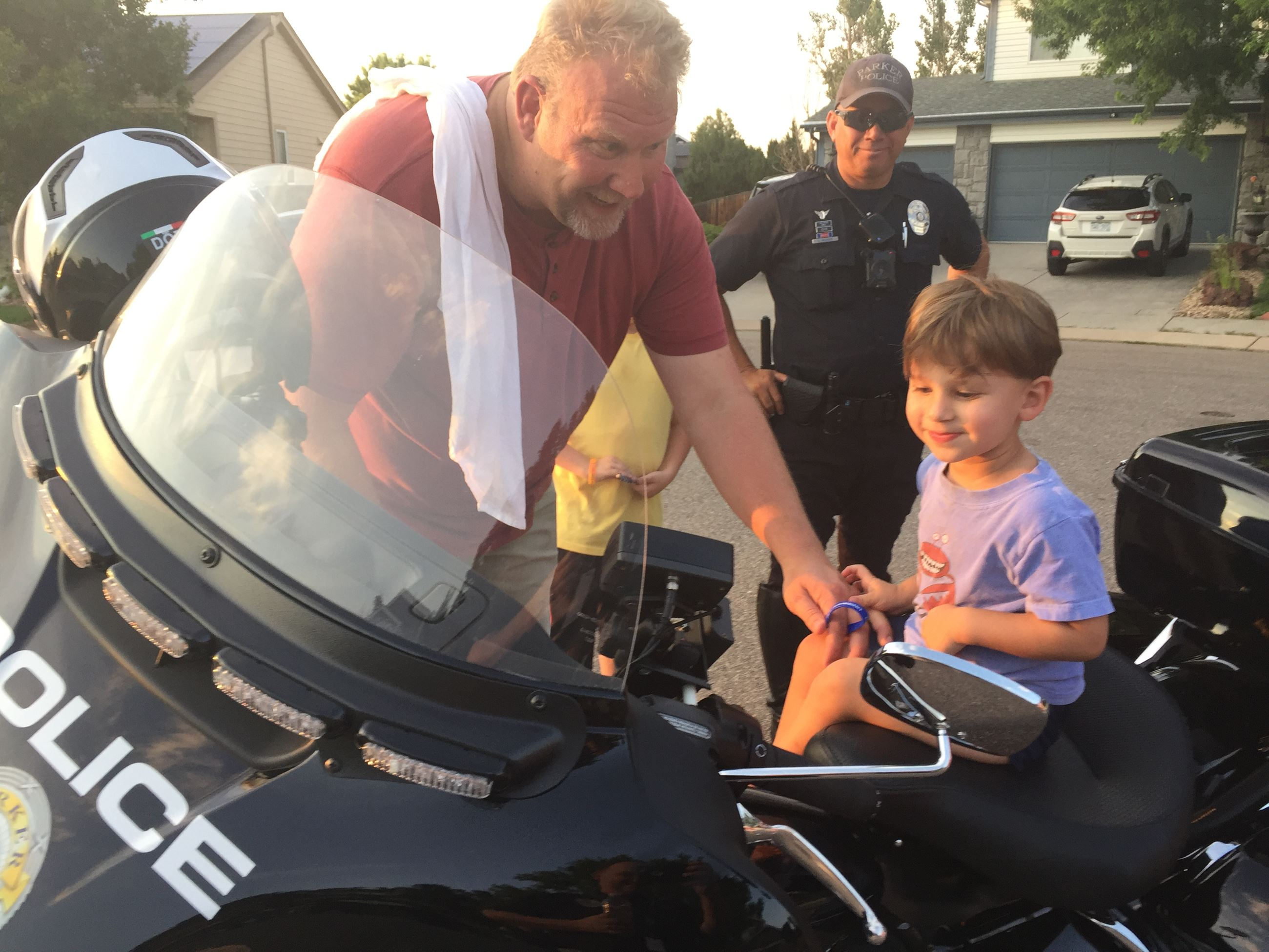small child sitting on police motorcycle